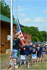 Girl Scout Troop, with assistance from VM Fire Department - Raising the flags